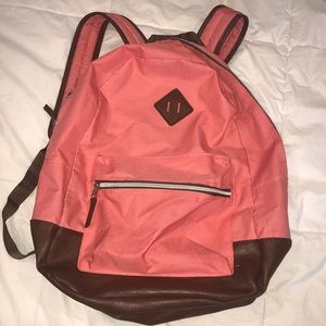 pink and brown leather backpack